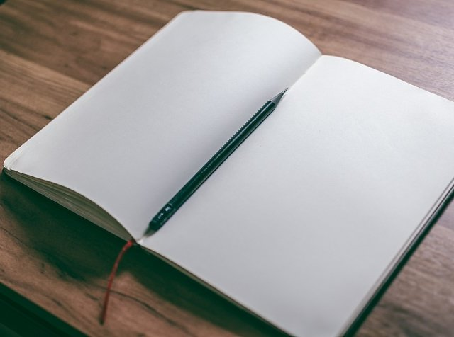 white-book-page-with-black-pen-942871